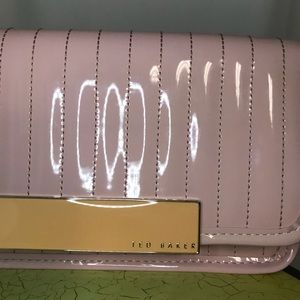 Ted Baker Pink Polyvinyl clutch. In Ted We Trust !